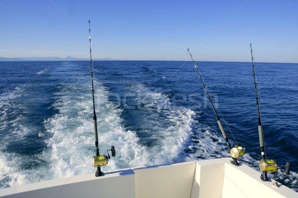 Fishing rod and reel on boat, fishing in blue ocean Stock photo © lunamarina