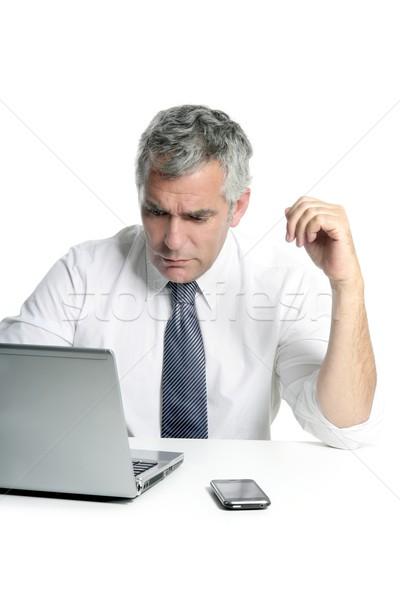 businessman senior gray hair working laptop Stock photo © lunamarina