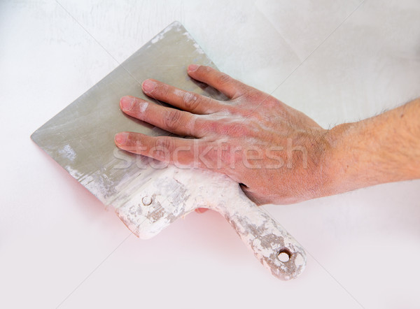 Plastering wall with plaste and plaster spatula trowel Stock photo © lunamarina