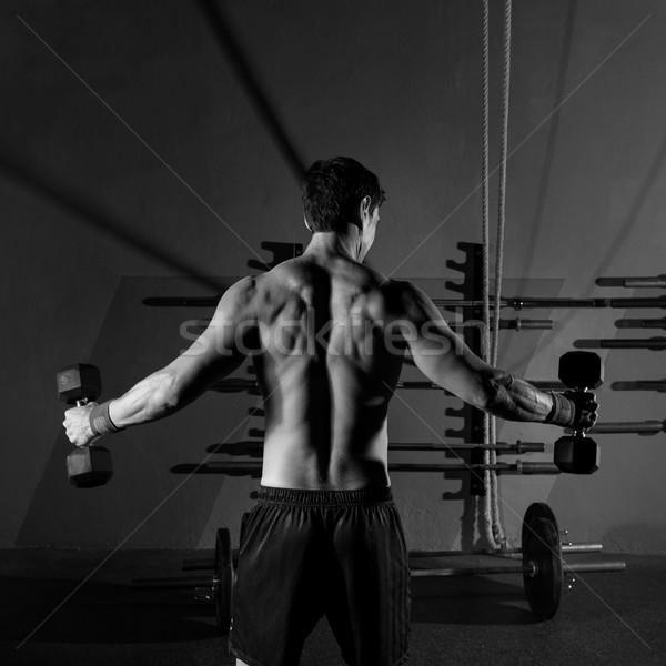 hex dumbbells man workout rear view at gym Stock photo © lunamarina