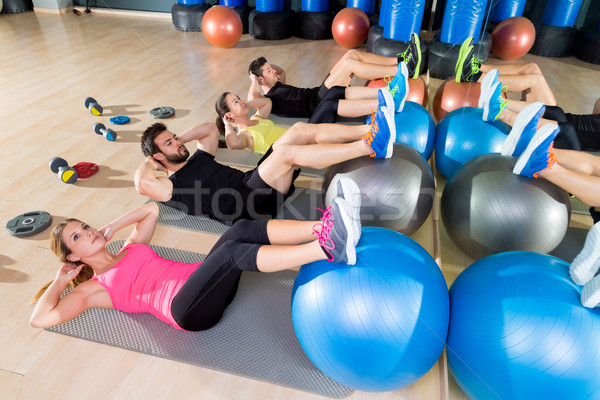 Fitball crunch training group core fitness at gym Stock photo © lunamarina