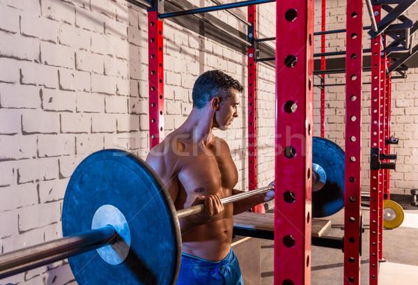 Bilanciere sollevamento pesi uomo palestra allenamento Foto d'archivio © lunamarina