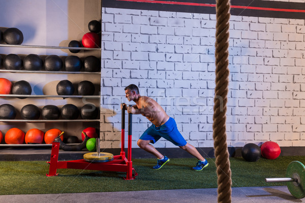 sled push man pushing weights workout Stock photo © lunamarina