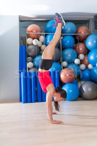 handstand woman workout at gym and swiss balls Stock photo © lunamarina