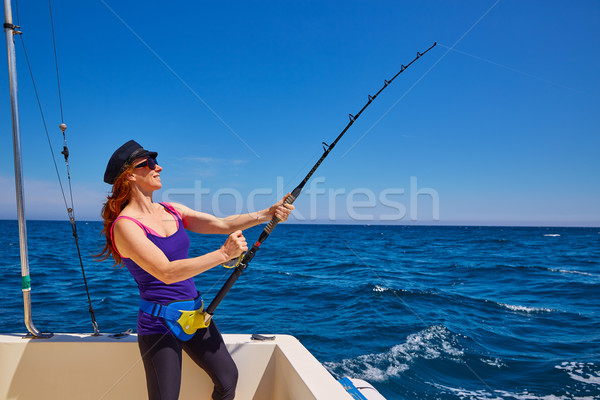 Beautiful woman girl fishing rod trolling in boat Stock photo © lunamarina
