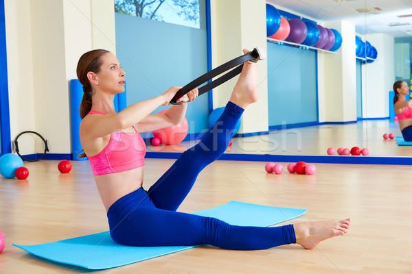 Pilates woman scissor magic ring exercise workout Stock photo © lunamarina