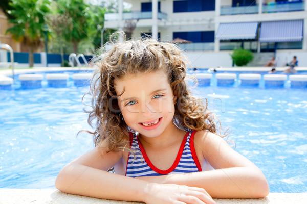 happy kid girl smiling at swimming pool Stock photo © lunamarina
