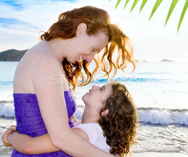 Daughter and mother hug on the Ibiza beach Stock photo © lunamarina