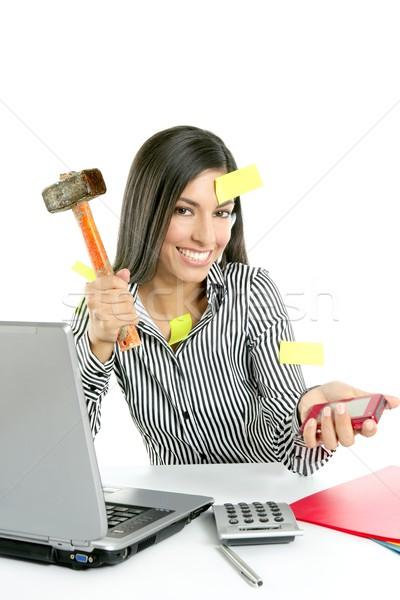 Angry brunette businesswoman with hammer Stock photo © lunamarina