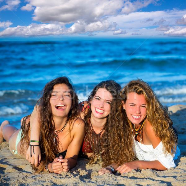 Stock photo: Girls friends having fun happy lying on the beach
