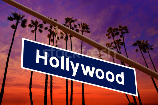 Hollywood California road sign on redlight with pam trees  photo Stock photo © lunamarina