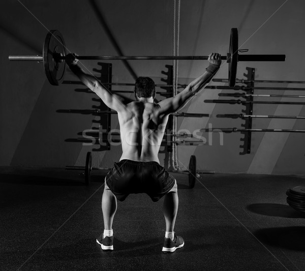 Barbell haltérophilie homme vue arrière entraînement gymnase Photo stock © lunamarina