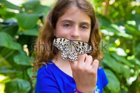 Girl holding Rice Paper butterfly Idea leuconoe Stock photo © lunamarina