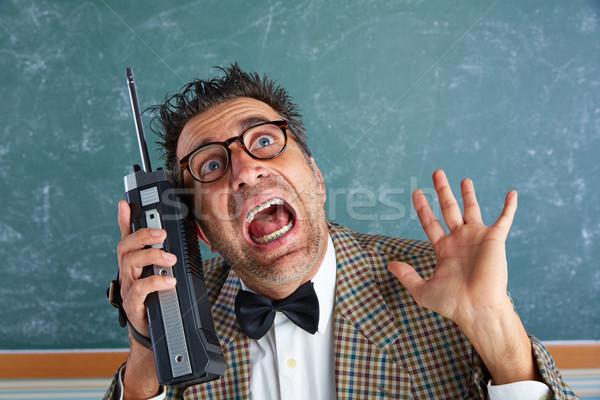Nerd silly private investigator retro walkie talkie Stock photo © lunamarina