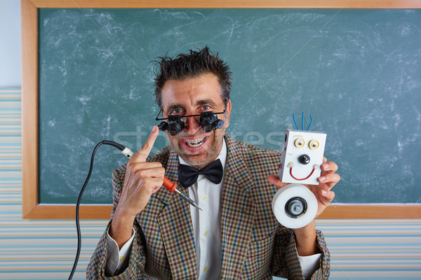 Nerd electronics technician silly welding robot Stock photo © lunamarina