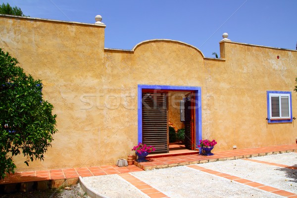 Beautiful house facade yellow blue mediterranean style Stock photo © lunamarina