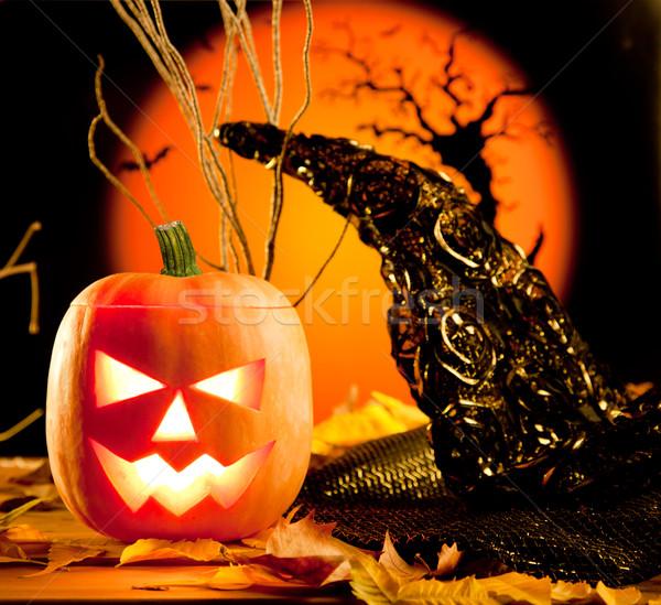 Halloween orange pumpkin on autumn leaves Stock photo © lunamarina