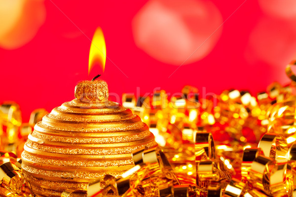 Christmas card of golden bauble candle on tinsel Stock photo © lunamarina