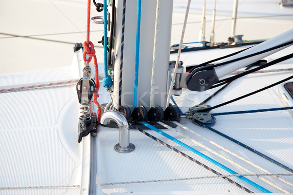 Detail of sailboat mast bottom with ropes Stock photo © lunamarina