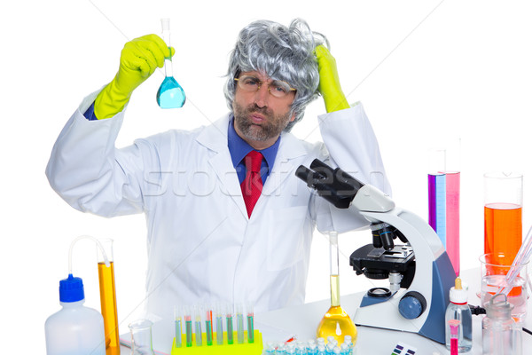 Stock photo: Crazy nerd scientist silly man on chemical laboratory