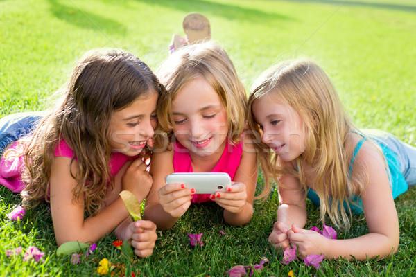 children friend girls playing internet with smartphone Stock photo © lunamarina