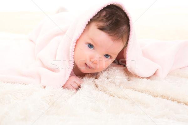 baby girl under hidden pink blanket on white fur Stock photo © lunamarina