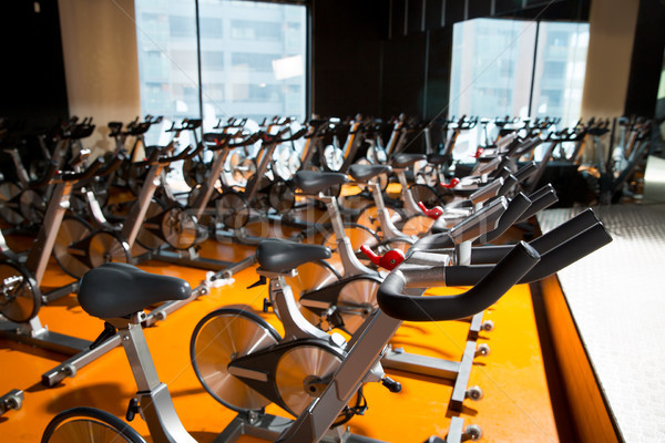Aerobics spinning exercise bikes gym room in a row Stock photo © lunamarina