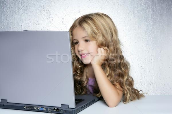 Student little school girl on laptop compute Stock photo © lunamarina