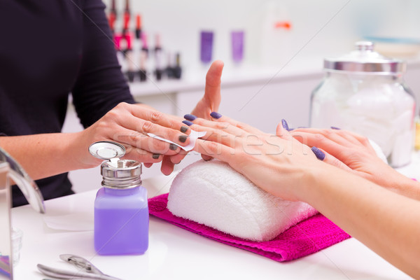 Nails saloon woman nail polish remove with tissue Stock photo © lunamarina