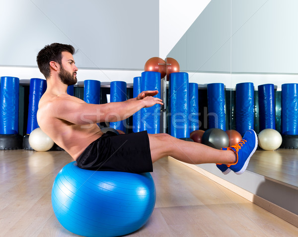 Fitball abdominal balance crunch Swiss ball man Stock photo © lunamarina