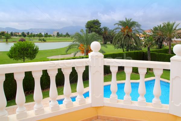 Golf course from pool housel white balustrade Stock photo © lunamarina