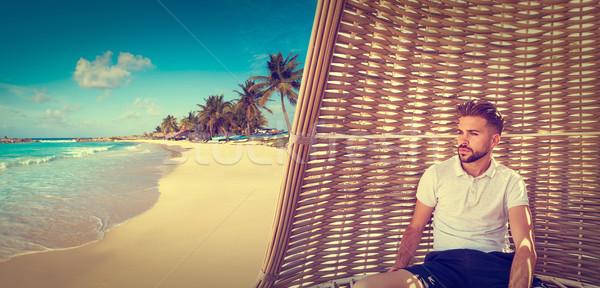 молодые борода человека зонтик тропический пляж пляж Сток-фото © lunamarina