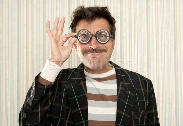 nerd silly crazy myopic glasses man funny gesture Stock photo © lunamarina