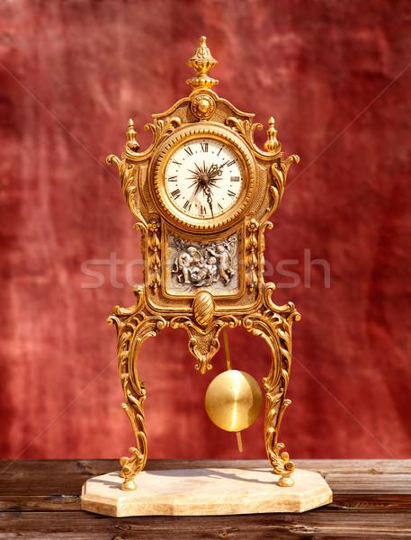Oude vintage gouden messing slinger klok Stockfoto © lunamarina