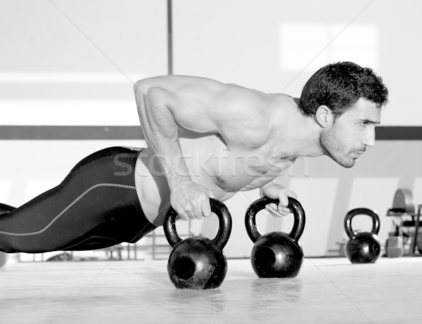 Gym man push-up strength pushup with Kettlebell  Stock photo © lunamarina