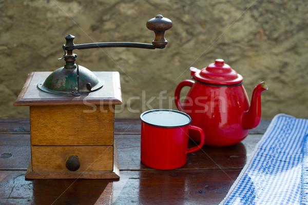 retro old coffee grinder with vintage red teapot Stock photo © lunamarina