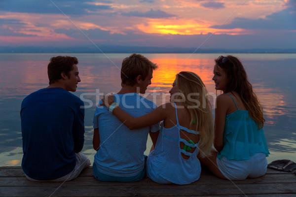 Friends group rear view at sunset fun together Stock photo © lunamarina