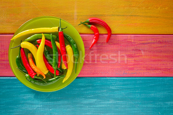 Colorful mexican chili peppers on wood table Stock photo © lunamarina
