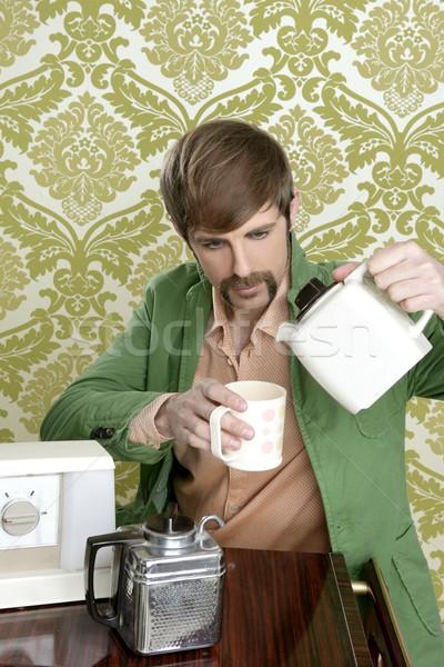 geek retro man drinking tea coffee vintage teapot Stock photo © lunamarina