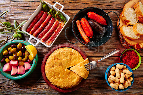 Tapas mix spanish potatoes omelette sausages Stock photo © lunamarina