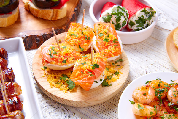 Tapas mix and pinchos food from Spain recipes also pintxos  Stock photo © lunamarina