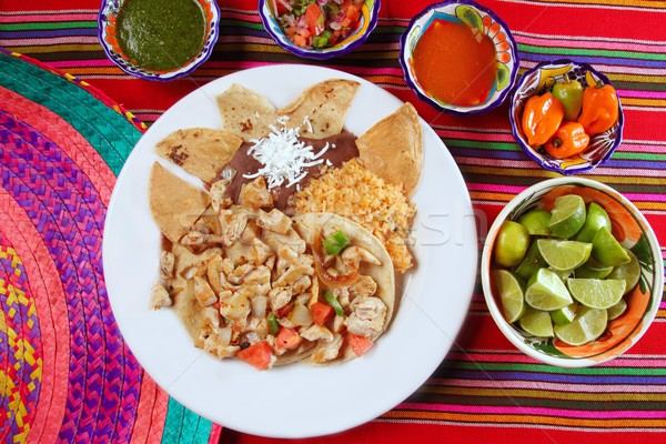 Chicken tacos Mexican style chili sauce and nachos Stock photo © lunamarina
