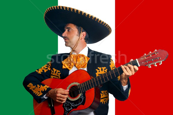 Charro Mariachi playing guitar in Mexico flag Stock photo © lunamarina
