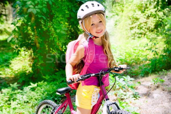 Gyerekek lány lovaglás bicikli szabadtér erdő Stock fotó © lunamarina
