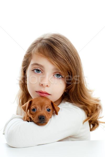 Brunette girl with puppy dog mini pinscher Stock photo © lunamarina