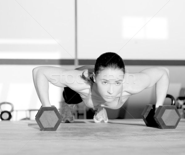 Stock photo: Gym woman push-up strength pushup with dumbbell