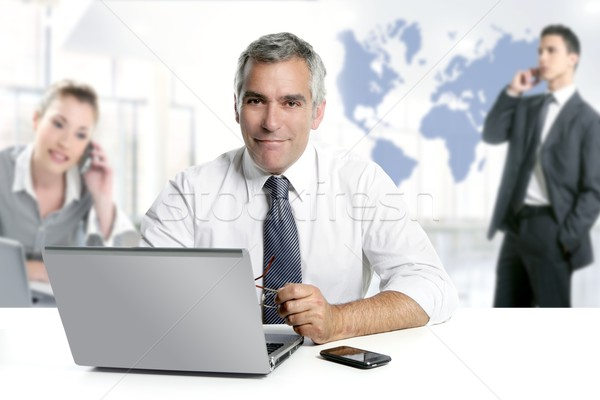 businessman senior expertise teamwork world map Stock photo © lunamarina