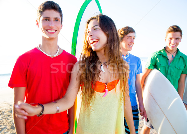 Teenager surfers boys and girls group happy Stock photo © lunamarina