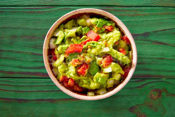 Guacamole with avocado and tomatoes mexican Stock photo © lunamarina