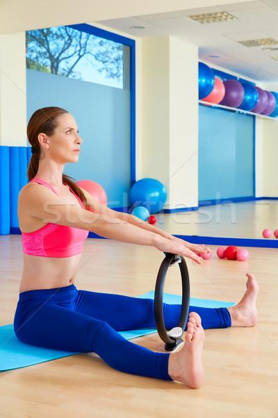 Pilates woman spine stretch forward magic ring Stock photo © lunamarina